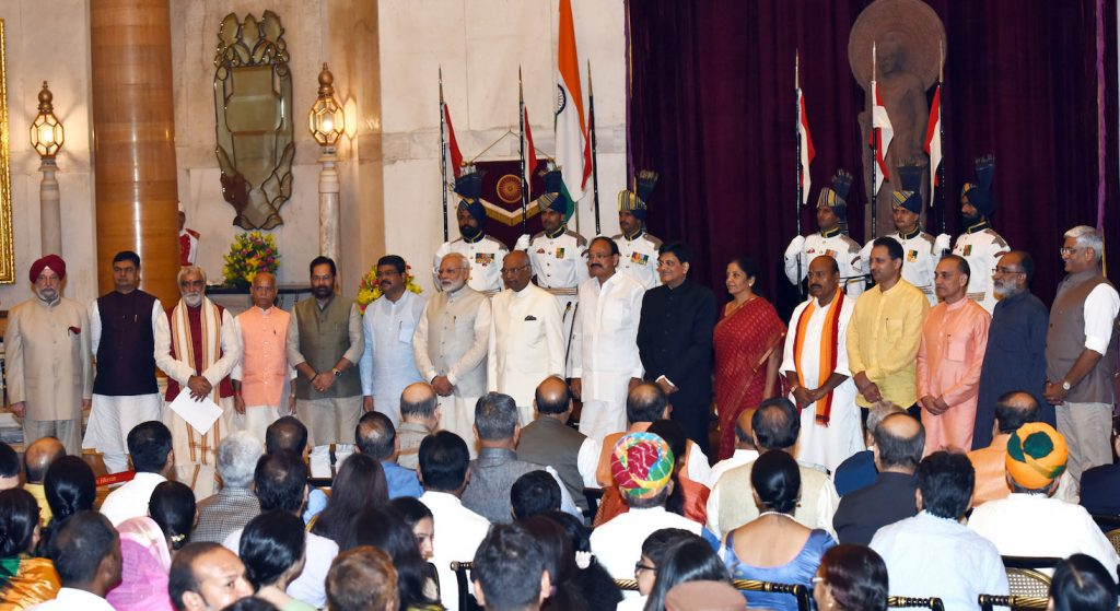 The newly sworn in ministers of the government stand with the Prime Minister, President and Vice President