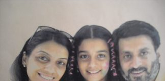 Aarushi Talwar with her parents