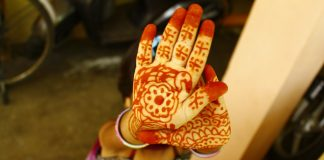 Child's hands with mehendi