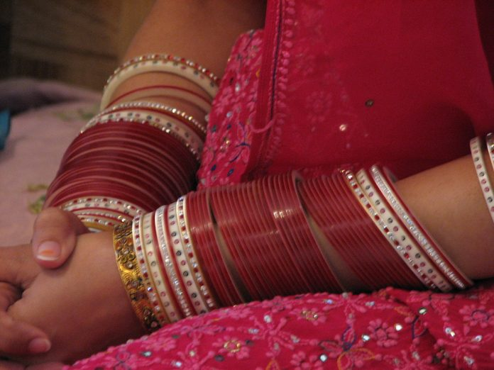 A woman's hand with bangles