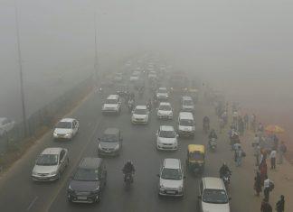 Cars plying through smog in Delhi
