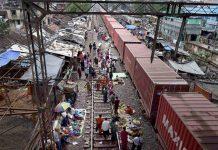 A vegetable market along train tracks