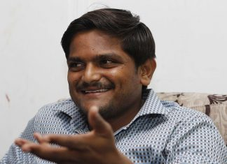 Hardik Patel addressing the media