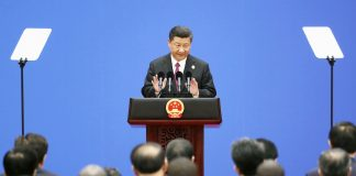Xi Jinping addressing the conference in Beijing