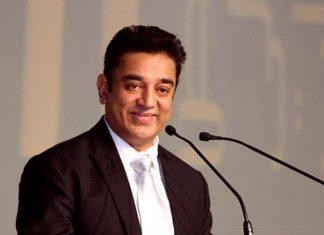 Kamal Haasan smiling at mics