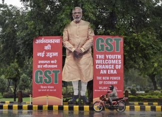 A giant cut-out of Prime Minister Narendra Modi installed at Ashok Road in favour of GST