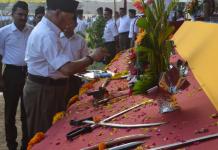 Mohan Bhagwat at arms worship