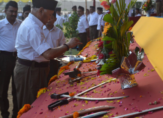 Mohan Bhagwat at arms worship