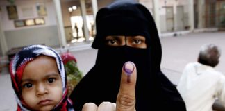 A muslim woman showing the polling mark on her finger during the 2012 polls.