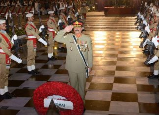 Retired Pakistan Army Chief General Raheel Sharif salutes at a ceremony