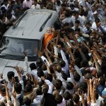 A crowd around Narendra Modi's car in Ahmedabad
