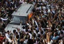 A crowd around Narendra Modi's car in Ahmedabad