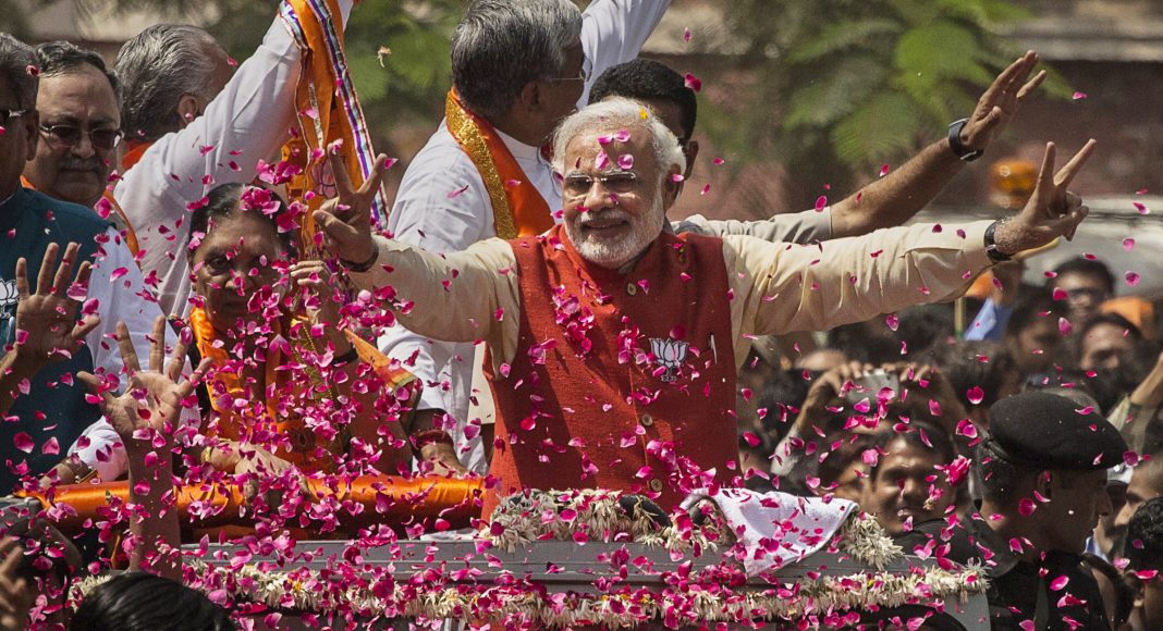 Supporters throw flower petals at BJP leader Narendra Modi