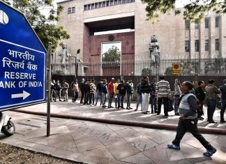 People stand in queue in front of RBI