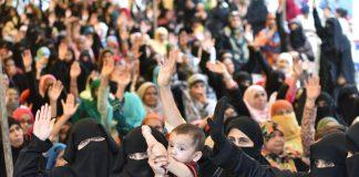 muslim women holding a babt, celebrating the triple talaq bill