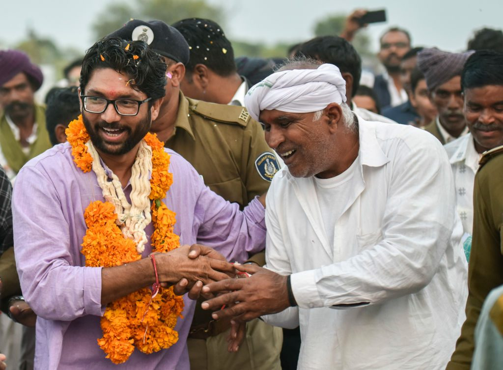Jignesh Mevani greets people during his election campaign in Vadgam, India