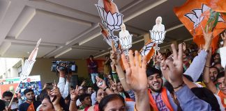 BJP workers celebrate their victory in the Assembly elections