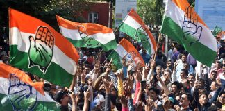 Congress party supporters celebrate in Ahmedabad