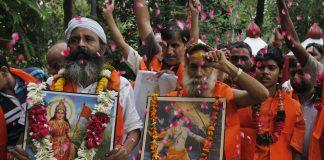 Delhi Sadhu Sants and Vishva Hindu Parishad (VHP) workers shout slogans for the Ram temple in Ayodhya