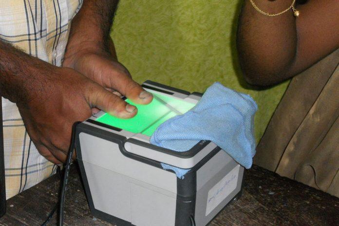 A person giving biometrics for Aadhaar