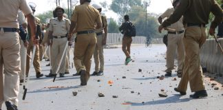 Police arrive to control the situation after an incident of violent clash at Ambedkar Nagar