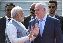 Prime Minister Narendra Modi talks his Israeli counterpart Benjamin Netanyahu
