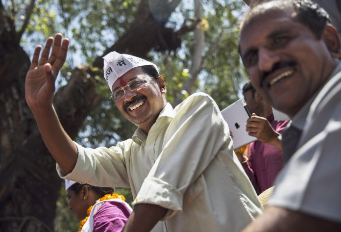 AAP chief Arvind Kejriwal waves to supporters while campaigning in 2014 in New Delhi.