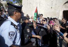 Israeli policemen detain Palestinians in Israel