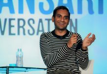 Aziz Ansari speaks onstage
