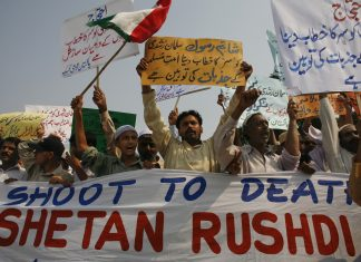 Protesters chant slogans to condemn Britain's knighting of Salman Rushdie