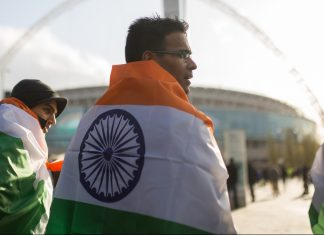 People wear the colors of the Indian flag