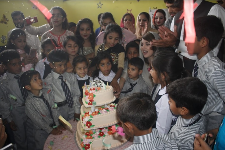Pakistani children celebrating birthday