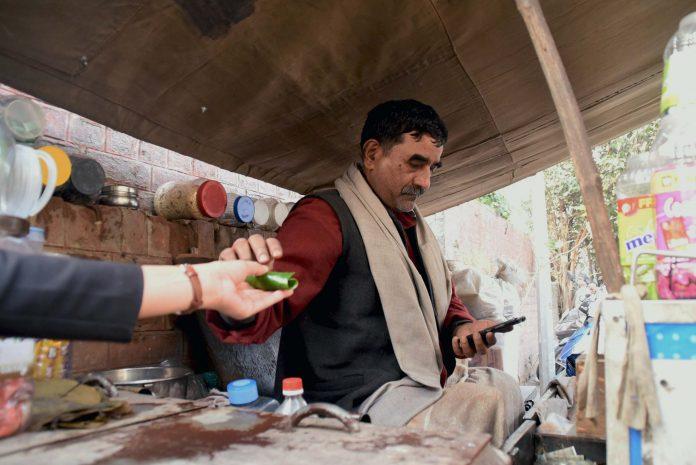 Balbir Chaurasia using his smartphone