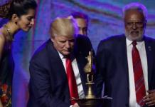 Donald Trump lights a candle at a Hindu-American rally