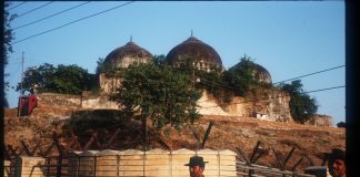 A member of the border security force guards the Babri Masjid |Robert Nickelsberg/Liaison