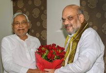 Nitish Kumar and Amit Shah exchange greetings at the state guest house in Patna / PTI