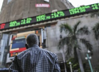 A man looks at an electronic ticker displayed outside BSE   Dhiraj Singh/Bloomberg