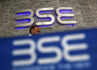 A man walks past the Bombay Stock Exchange (BSE) logo in Mumbai   Dhiraj Singh/Bloomberg