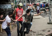 A photographer is targetted during a student protest in Dhaka on August 5, 2018, following the deaths of two college students in a road accident. Mamunur Rashid/NurPhoto via Getty Images