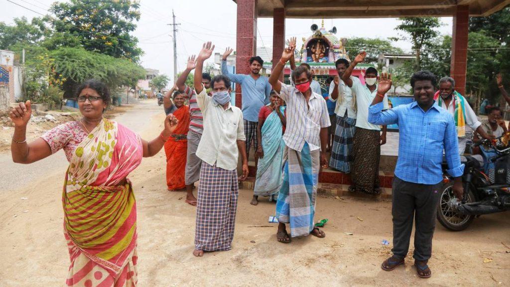 Krishnapatnam residents raise their hands when asked who all had taken Anandaiah's herbal concoction | Photo: Manisha Mondal | ThePrint